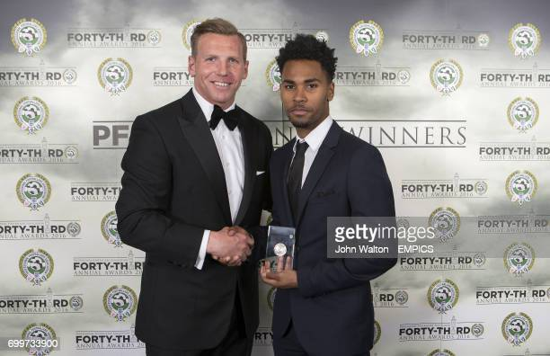 Chairman of the Professional Footballers' Association Ritchie Humphreys presents Walsall's Rico Henry with his PFA League One Team of the Year Award...