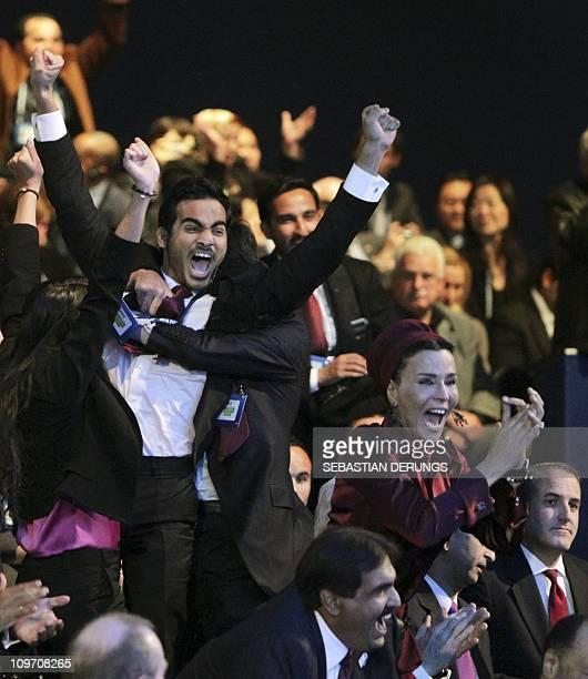 Chairman of the Qatar 2022 bid committee Sheikh Mohammed bin Hamad alThani reacts next to Sheikha Moza wife of Qatar's Emir Sheikh Hamad bin Khalifa...