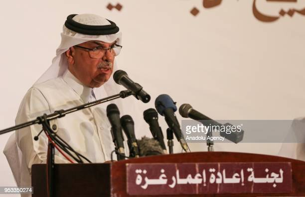 Chairman of the Qatari Committee for the Reconstruction of Gaza Ambassador Mohammed AlEmadi speaks to press members during the signing ceremony of...