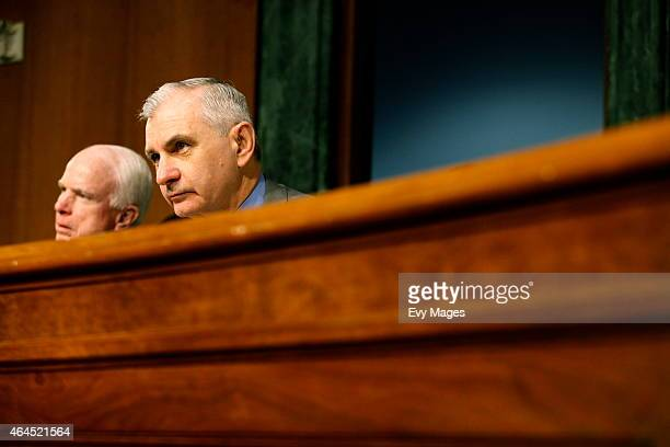 Chairman of the Senate Armed Services Committee John McCain and Jack Reed listen to the testimony of James Clapper Director of National Intelligence...