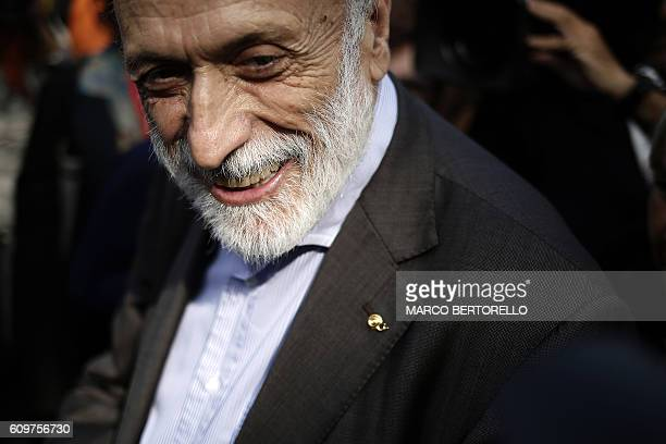 Chairman of the Slow Food Salone del Gusto and Terra Madre Carlo Petrini smiles as he visits the show on September 22 2016 in Turin / AFP / MARCO...