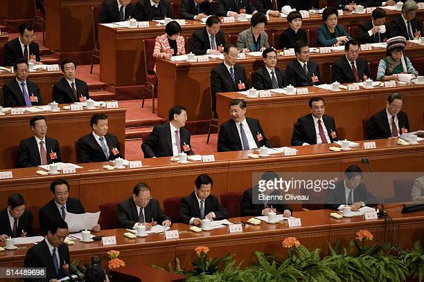 Chairman of the Standing Committee of the National People's Congress Zhang Dejiang and Chinese President Xi Jinping speak together afer Zhang...