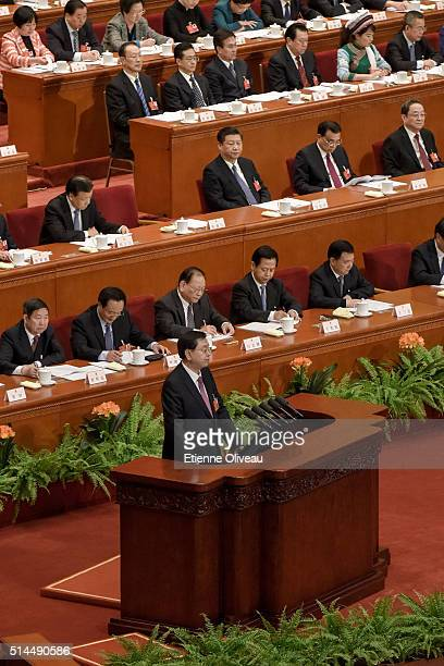 Chairman of the Standing Committee of the National People's Congress Zhang Dejiang delivers his work report during the 2nd plenary session of the...