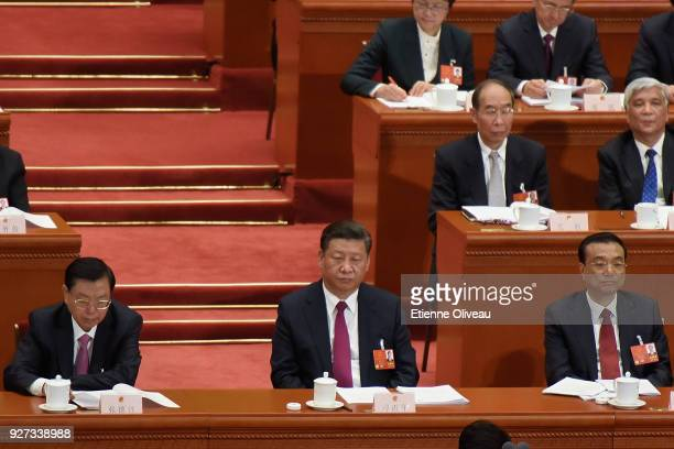 Chairman of the Standing Committee of the National People's Congress Zhang Dejiang Chinese President Xi Jinping and Chinese Premier Li Keqiang listen...