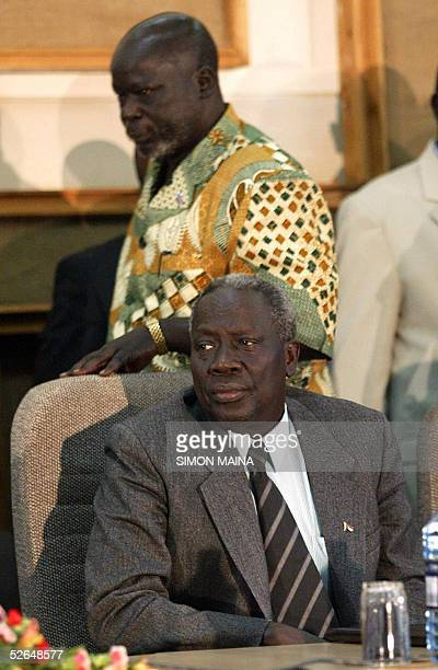 Chairman of the Sudanese People Liberation Movement Army John Garang walks past a delegate at a major reconciliation conference 19 April 2005 in...
