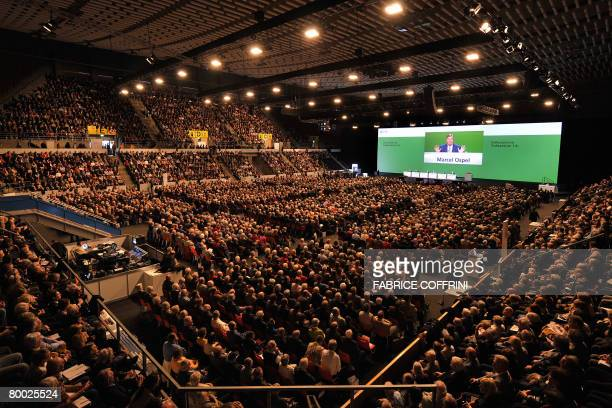 Chairman of the Swiss bank UBS Marcel Ospel is seen on a giant screen during an extraordinary shareholder meeting on February 27 2008 in Basel...