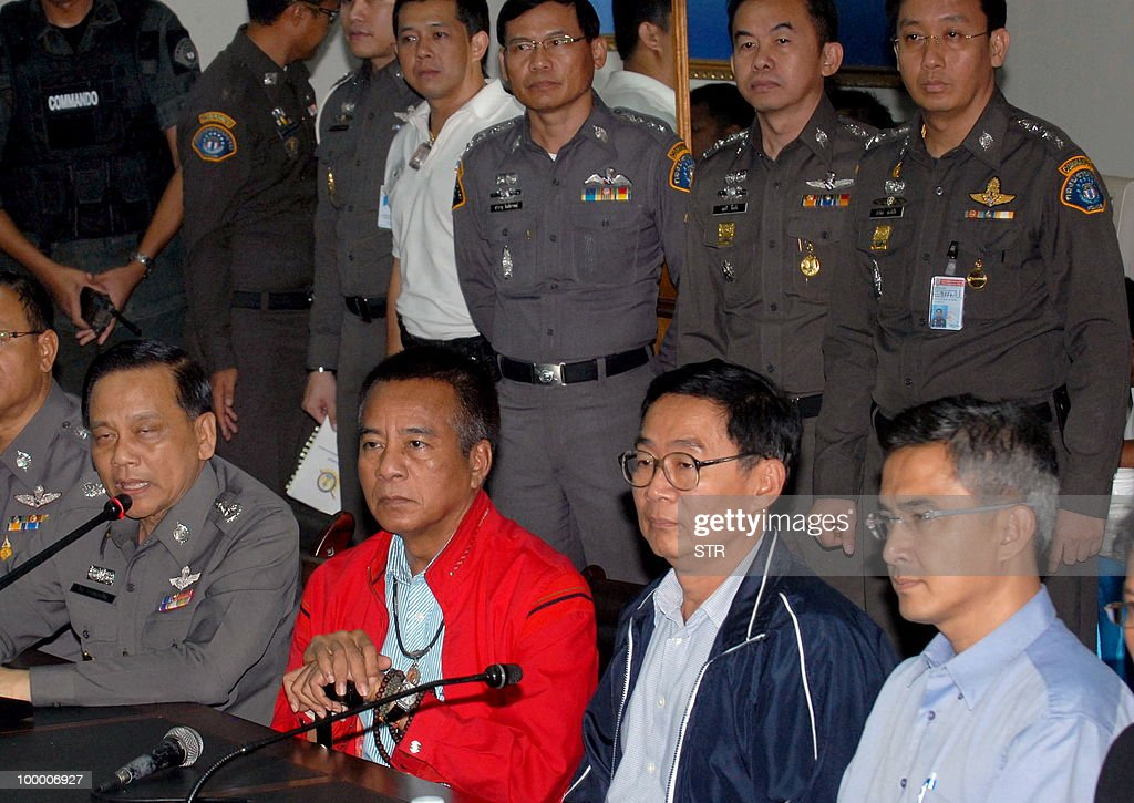 Chairman of the United Front for Democracy against Dictatorship, Veera Musikapong (2nd L) sits next to the other Red Shirt leaders, Weng Tojirakarn (2nd R) Korkaew Pikulthong (L) during surrendered at Crime Suppression division in Bangkok on May 20, 2010. A top Thai protest leader urged supporters of the anti-government 'Red Shirt' movement to refrain from violence after riots in the capital, saying 'democracy cannot be built on revenge.'