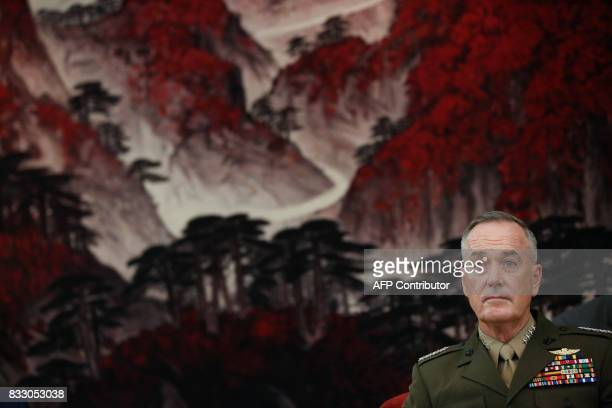Chairman of the US Joint Chiefs of Staff General Joseph Dunford attends a meeting with Chinese vice chairman of the Central Military Commission Fan...