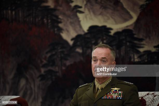 Chairman of the US Joint Chiefs of Staff General Joseph Dunford listens as he meets Chinese vice chairman of the Central Military Commission Fan...
