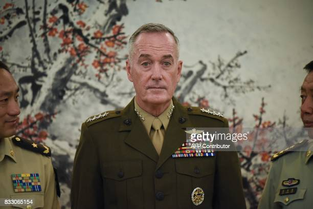 Chairman of the US Joint Chiefs of Staff General Joseph Dunford poses for a group photo with Chinese vice chairman of the Central Military Commission...