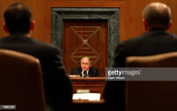 Chairman of the U.S. Senate Governmental Affairs permanent investigations Subcommittee, Senator Carl Levin , listens to testimony from David...