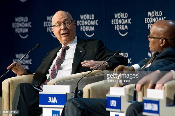 Chairman of the World Economic Forum, Klaus Schwab gives a speech next to South Africa's President Jacob Zuma during the second day of the World...