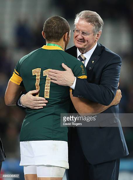 Chairman of the World Rugby Bernard Lapasset hugs Bryan Habana of South Africa after the 2015 Rugby World Cup Bronze Final match between South Africa...
