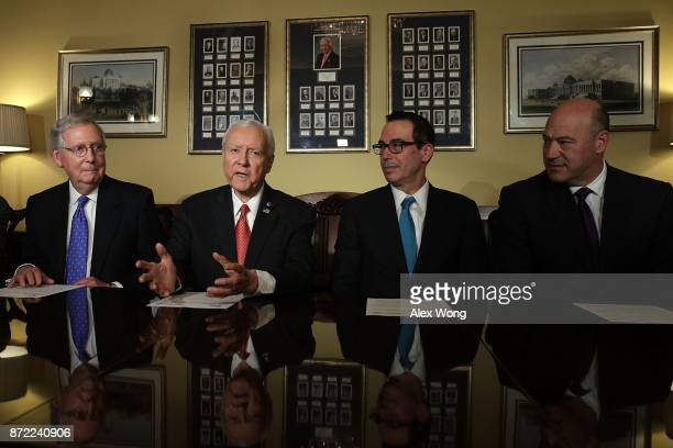 Chairman of US Senate Finance Committee Sen Orrin Hatch speaks as Senate Majority Leader Sen Mitch McConnell Secretary of the Treasury Steven Mnuchin...