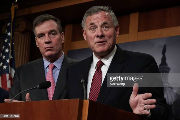Chairman of US Senate Intelligence Committee Sen Richard Burr speaks as committee Vice Chairman Sen Mark Warner listens during a news conference at...