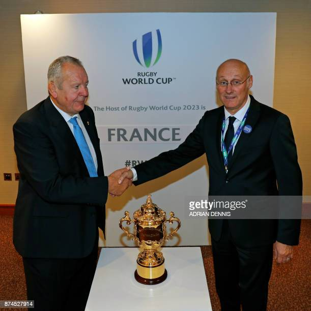 Chairman of World Rugby Bill Beaumont shakes hands with French rugby President Bernard Laporte after France is named to host the 2023 Rugby World Cup...