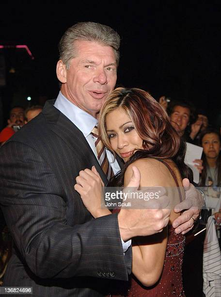 Chairman of WWE Vince McMahon, and Melina, WWE Diva