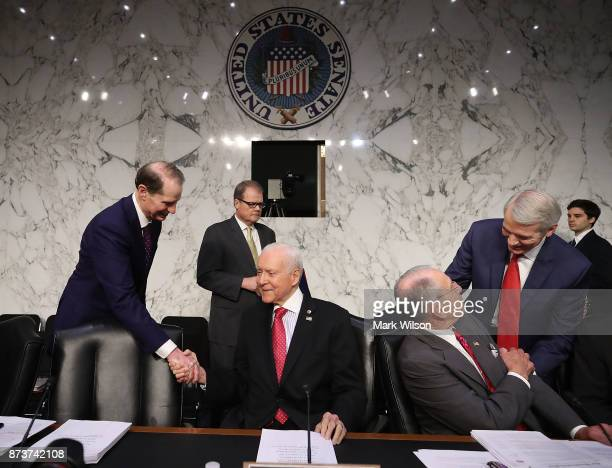 Chairman Orrin Hatch is greeted by Sen Ron Wyden while Sen Rob Portman greets Sen Chuck Grassley during a Senate Finance Committee markup of the Tax...