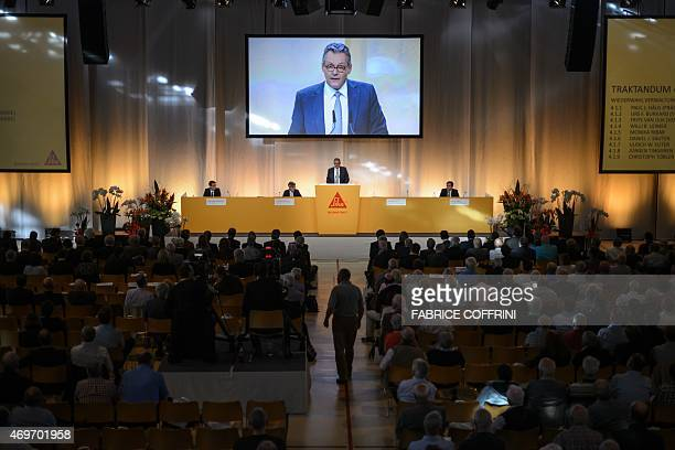 Chairman Paul Haelg addresses shareholders on April 14 2015 during a general assembly in Baar central Switzerland The annual meeting of Swiss...