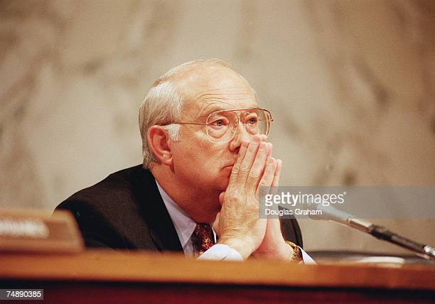 REPORT Chairman Phil Gramm RTexas listens to Alan Greenspan chairman Board of Governors Federal Reserve System testify during the hearing on monetary...