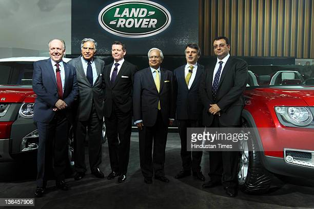 Chairman Ratan Tata with Cyrus Mistry Deputy Chairman and ChairmanDesignate of Tata Group pose for photos at the Land Rover pavilion during 11th Auto...