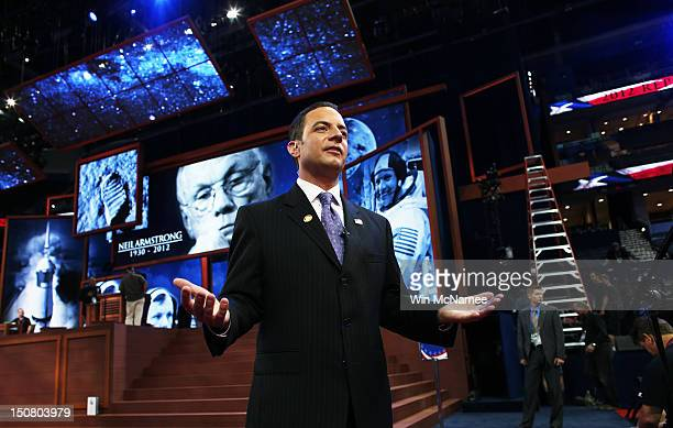 Chairman Reince Priebus stands in front of a tribute displayed on stage for recently deceased NASA astronaut Neil Armstrong ahead of the Republican...