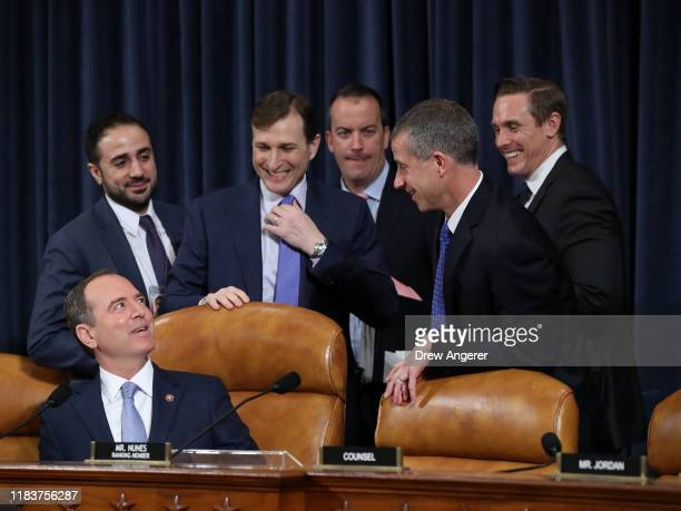 Chairman Rep. Adam Schiff talks with Democratic Counsel Daniel Goldman , GOP Counsel Steve Castor and aides before testimony by Fiona Hill, the...