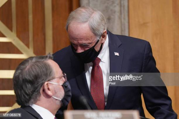 Chairman Sen. Gary Peters speaks to Sen. Tom Carper at the confirmation hearing for Neera Tanden, nominee for Director of the Office of Management...
