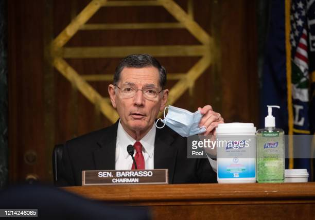 Chairman Sen. John Brasso puts on a mask at a hearing titled Oversight of the Environmental Protection Agency in the Dirksen Senate Office Building...