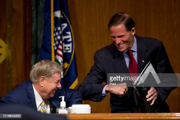 Chairman Sen Lindsey Graham left and Sen Richard Blumenthal right greet each other with an elbow bump during a Senate Judiciary Committee hearing to...