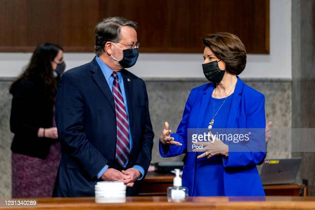 Chairman Senator Gary Peters and Chairwoman Senator Amy Klobuchar speak before the start of a Senate Homeland Security and Governmental Affairs &...