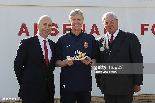 Chairman Sir Chips Keswick and CEO Ivan Gazidis present Arsene Wenger with a gold cannon to commemorate his 1000th game as Arsenal manager at London...