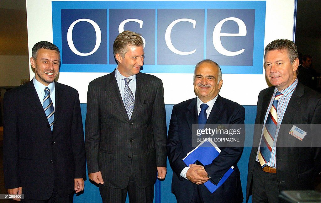 OSCE chairman Solomon Passy, Belgium's Prince Philippe, Jordan's Prince Hassan bin Tallal and Belgian Foreign Minister Karel De Gucht arrive for the OSCE (Organization for Security and Cooperation in Europe) conference on Tolerance and the Fight against racism, xenophobia and discrimination, 13 September 2004 in Brussels.