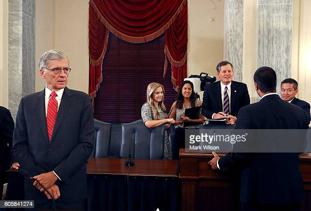 Chairman Tom Wheeler waits to testify before the Senate Commerce Science and Transportation Committee on Capitol Hill September 15 2016 in Washington...