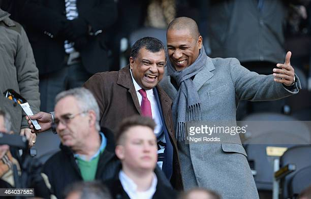 Chairman Tony Fernandes and QPR Director of football Les Ferdinand in discussion prior to the Barclays Premier League match between Hull City and...