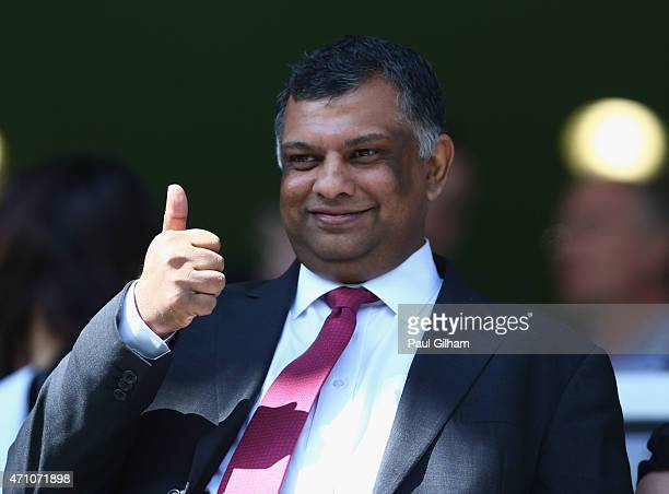 Chairman Tony Fernandes gives the thumbs up during the Barclays Premier League match between Queens Park Rangers and West Ham United at Loftus Road...