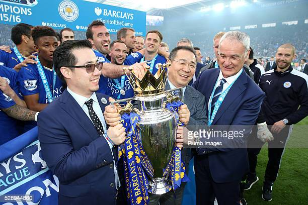Chairman Vichai Srivaddhanaprabha and Vice chairman Aiyawatt Srivaddhanaprabha of Leicester City lift the Premier League trophy after the Barclays...