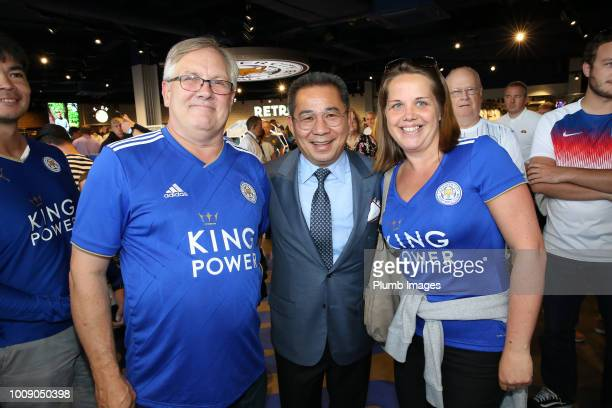 Chairman Vichai Srivaddhanaprabha of Leicester City poses with fans in the club fanstore ahead of the friendly match between Leicester City and...
