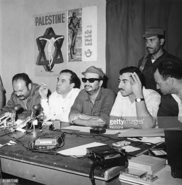 PLO Chairman Yasser Arafat at a press conference in Jordan following the formation of a joint committee by the Jordanian government and paramilitary...
