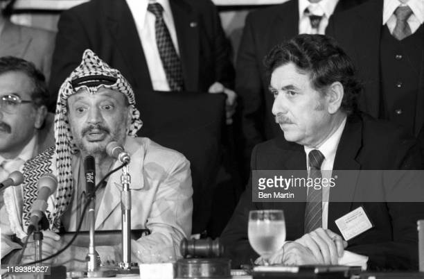 Chairman Yasser Arafat attending a press conference in Tokyo, during a four-day visit in which he was protected by 18,000 police, urging Japan to...