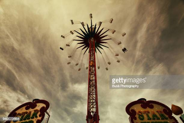 chairoplane ride at the christmas market near alexanderplatz, berlin, germany - sepia toned stock pictures, royalty-free photos & images