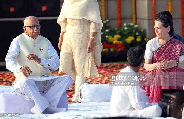 Chairperson and Congress President Sonia Gandhi and BJP Senior leader L K Advani paying homage to the Father of the Nation Mahatma Gandhi on the...