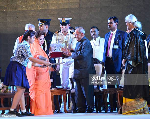 Chairperson Board of Governors Rajmata Madhavi Raje Scindia presenting memento to President Pranab Mukherjee during the 60th Founders Day...