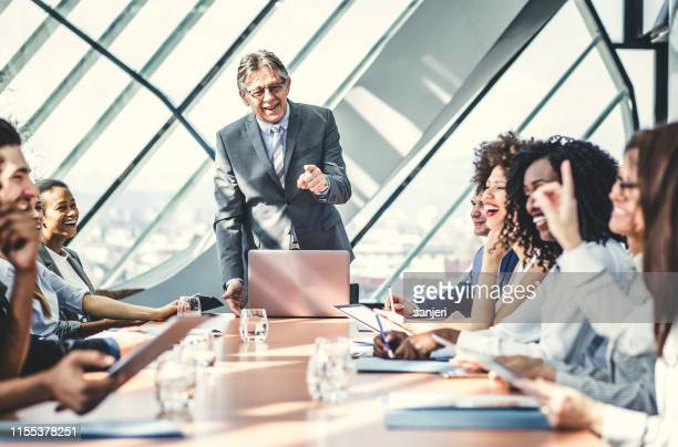 chairperson holding a business meeting - chairperson stock pictures, royalty-free photos & images