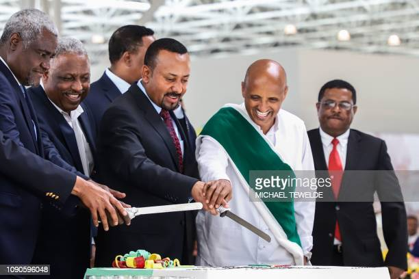 Chairperson of the African Union Commission Moussa Faki Mahamat Board Chairman of Ethiopian airlines Abadula Gemeda Ethiopia's Prime Minister Abiy...