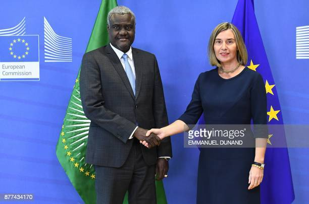 Chairperson of the African Union Commission Moussa Faki Mahamat is welcomed by EU foreign policy chief Federica Mogherini at the European Commission...