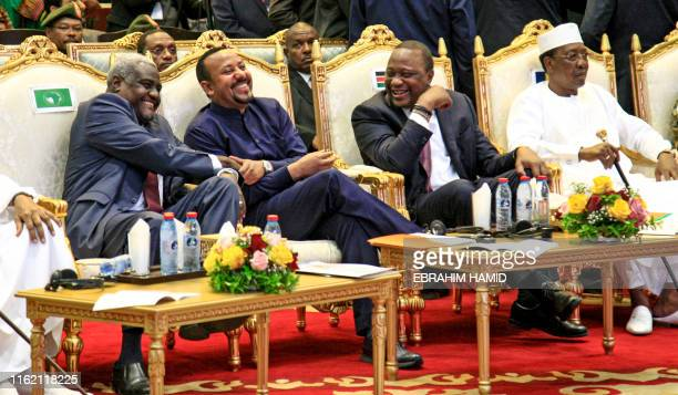 Chairperson of the African Union Commission Moussa Faki Mahamat, Ethiopian Prime Minister Abiy Ahmed, Kenyan President Uhuru Kenyatta, and Chadian...