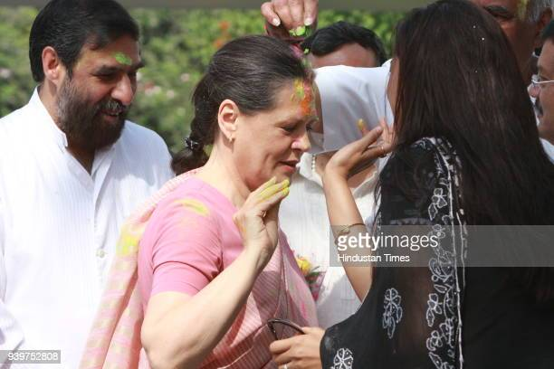 "Chairperson of the Congress-led UPA government and Congress Party President Sonia Gandhi celebrates ""Holi"" with party leaders in New Delhi"