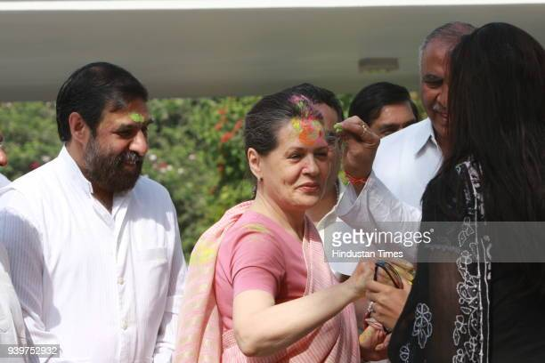 """Chairperson of the Congress-led UPA government and Congress Party President Sonia Gandhi celebrates """"Holi"""" with party leaders in New Delhi"""