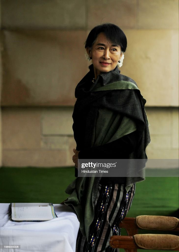 Chairperson of The National League for Democracy of Myanmar, Aung San Suu Kyi smiles after paying tribute at Rajghat, The Memorial to Mahatma Gandhi on November 14, 2012 in New Delhi, India. Photo by Ajay Aggarwal/Hindustan Times